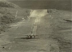 A Caribou lands at the Walong ALG in 1963