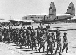 Connie BG575 transporting troops