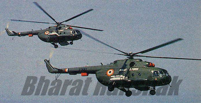 A pair of Mi-17s armed with UB-57 57mm rocket pods