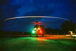 Lights on! Mi-8 on a helipad