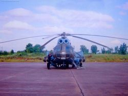 An Mi-8 helicopter equipped with four rocket pods.