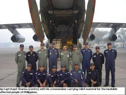 Gp Capt Rajat Sharma and his  aircrew on supply mission to Philippines