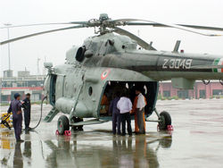 IAF personnel loading relief materials for the flood-affected people in Gujarat on July 3, 2005.