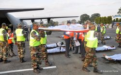 Army paramedics offload a patient from an IAF C-130J at Bagdogra