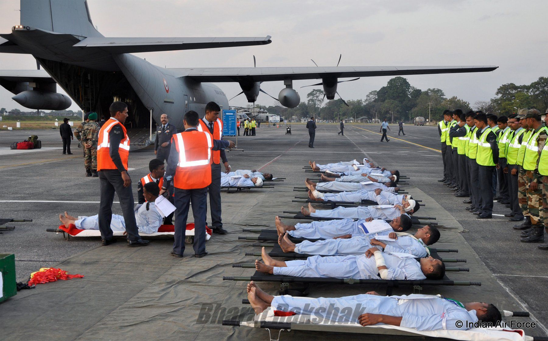 Patients on stretchers airlifted from Jorhat, Assam in an IAF C-130J in a mock exercise