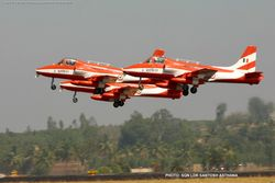 Aircraft in a formation take off at Aero India