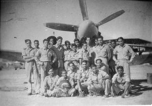Airmen with one of the Spitfire XIVs