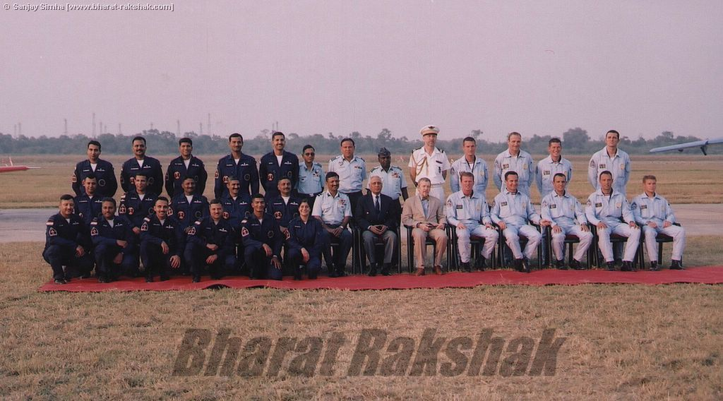 The two teams pose with the dignitaries at the end of the airshow