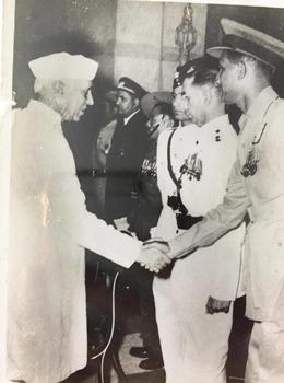 Pandit Nehru congratulating Warrant Officer Paddington.