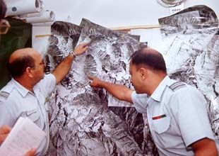 Sqn. Ldr. Jacob and Sqn. Ldr. Chandla with a photo mosaic of Kargil sector