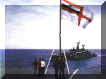 With the Indian Naval Flag flying high, personnel from the deck of INS Viraat watch INS Ganga. Image © Indian Navy