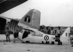 Auster TW379 being loaded into a C-47 Dakota