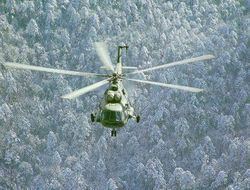 A Mi-17 flies over snow-brushed coniferous forests in the North.