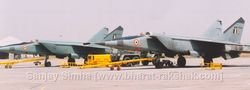Two MiG-25s  being maintained